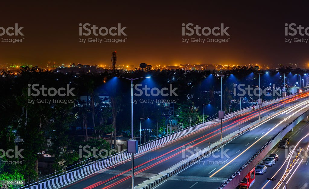 Freeway with car traffic and lights trails at night stock photo