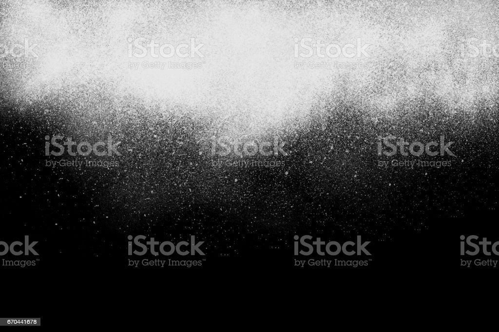 Freeze motion of  white powder exploding, isolated on black, stock photo