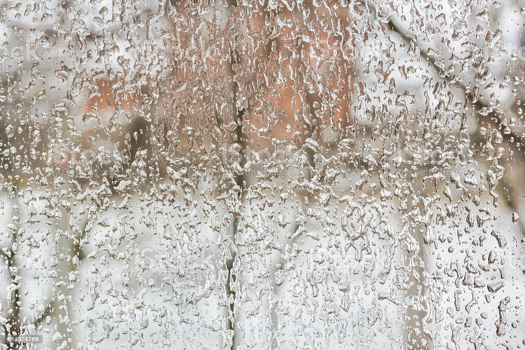Freezing rain outside the window on a foul winter day stock photo