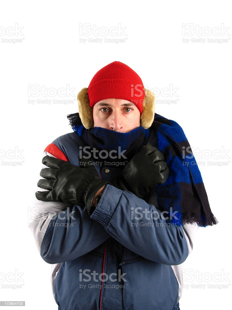 Freezing Shivering Man in Red Stocking Cap, Earmuffs, and Scarf stock photo