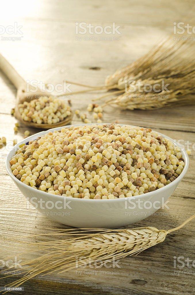 Fregola, typical pasta from Sardinia stock photo
