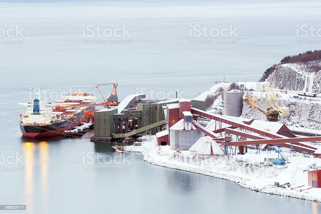 freight ship at Iron ore mine refinery Factory stock photo