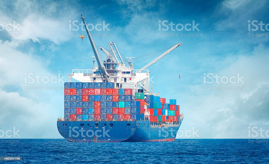Freight ship with cargo containers on the sea stock photo