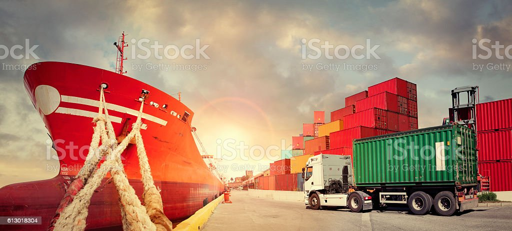 Freight ship with truck and cargo containers stock photo