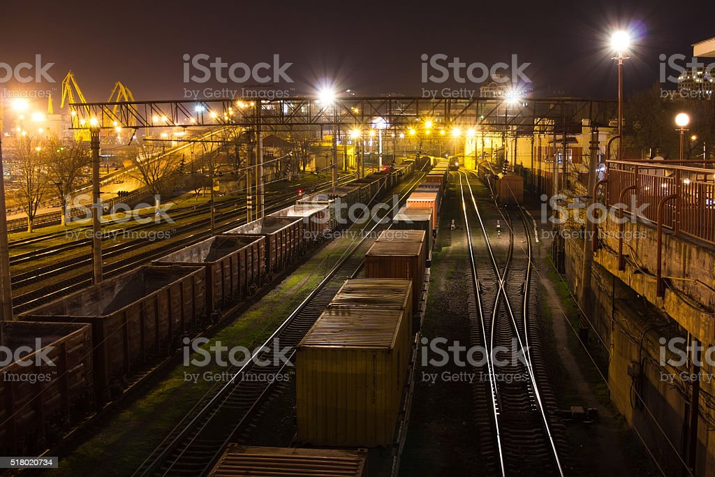 Freight Station with trains at night stock photo