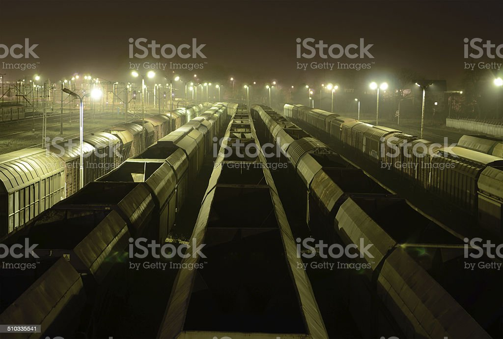 Freight Station with trains, cargo transportation at night. stock photo