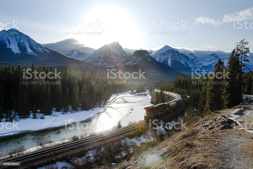 Freight Trail along Bow River in Winter, Canadian Rockies stock photo