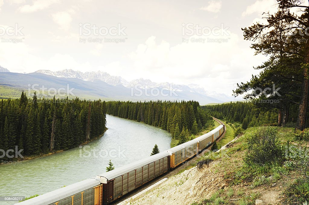 Freight train along  Bow River ,Bow Valley Parkway,Canada stock photo