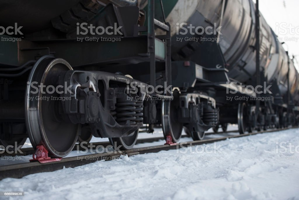 Railway oil tank wagon car carriage at station in winter. Focus on...