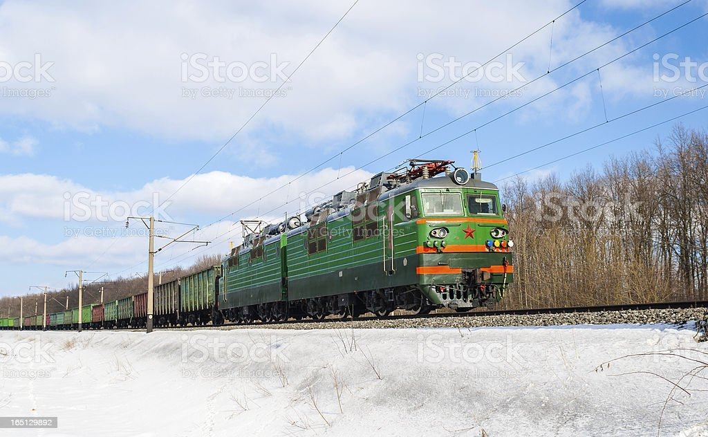 Freight train hauled by electric locomotive. Ukrainian railways royalty-free stock photo