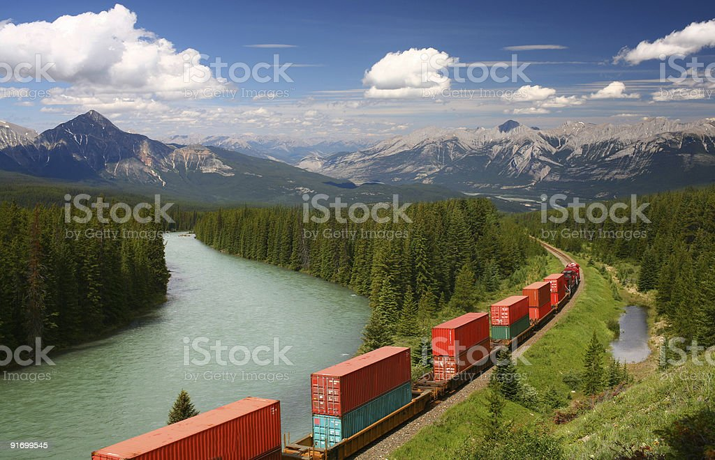 Freight train moving in Canadian Rockies, Banff National Park, stock photo