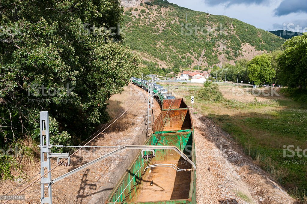 Freight train on an Iberian gauge railway track stock photo