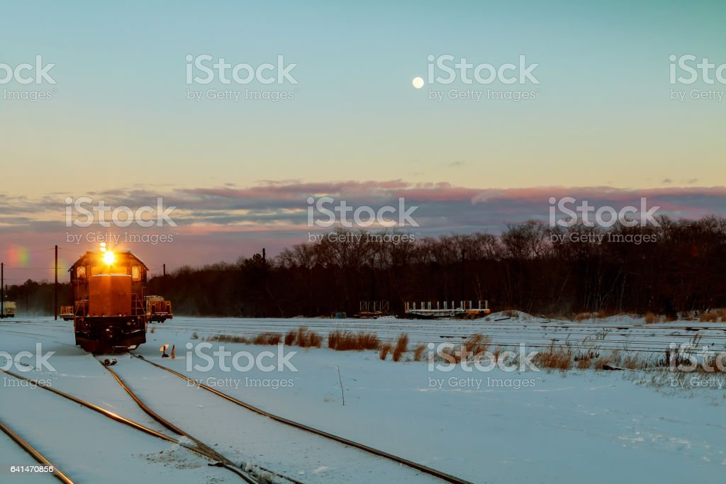 freight train travels through the vast expanses of snow-covered stock photo