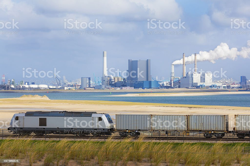 Freight train with industry stock photo