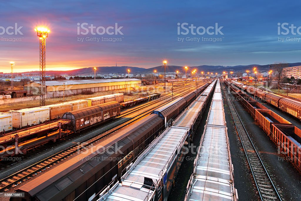 Freight Trains and Railways at dusk - Cargo transportation stock photo