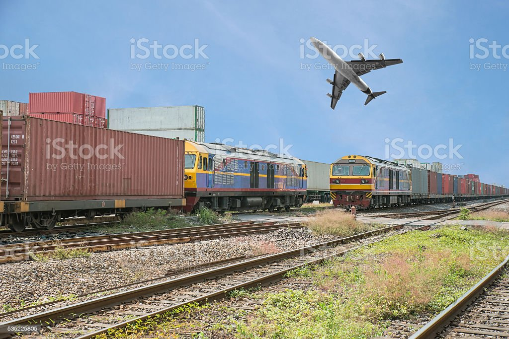 Freight trains in dock with airplane for logistics background stock photo