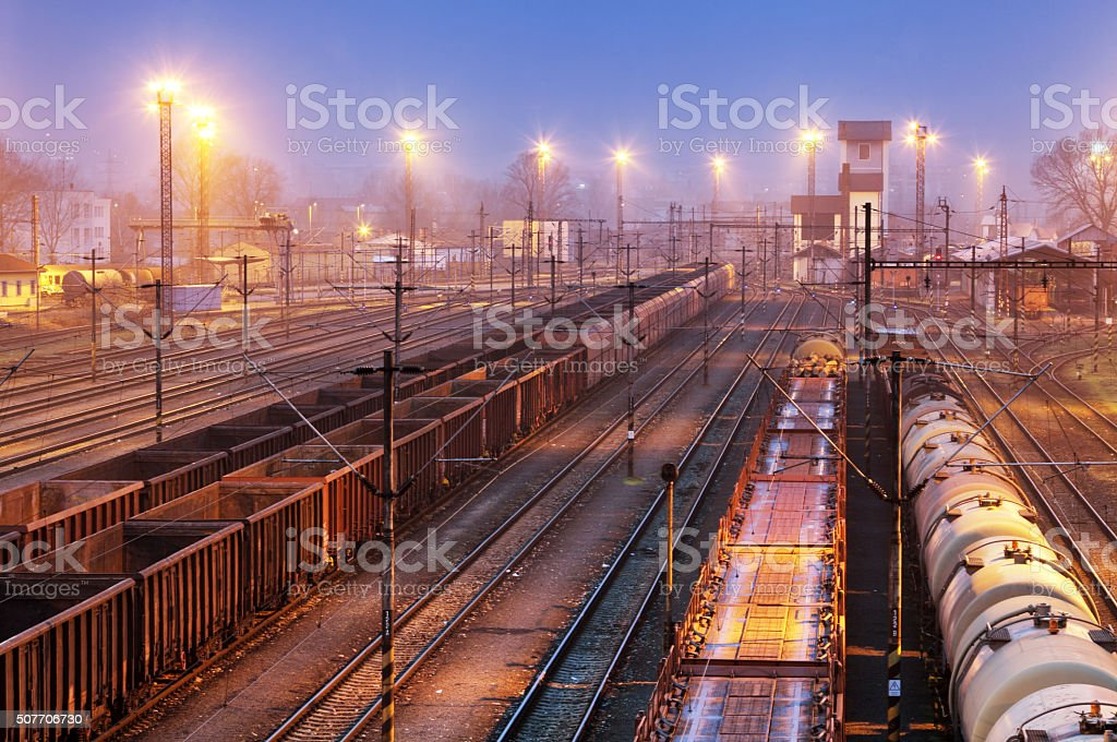 Freight Trains, Waggons and Railways in the sunset stock photo