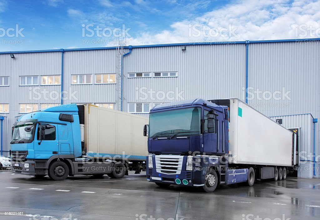 Freight Transportation - Truck in the warehouse stock photo