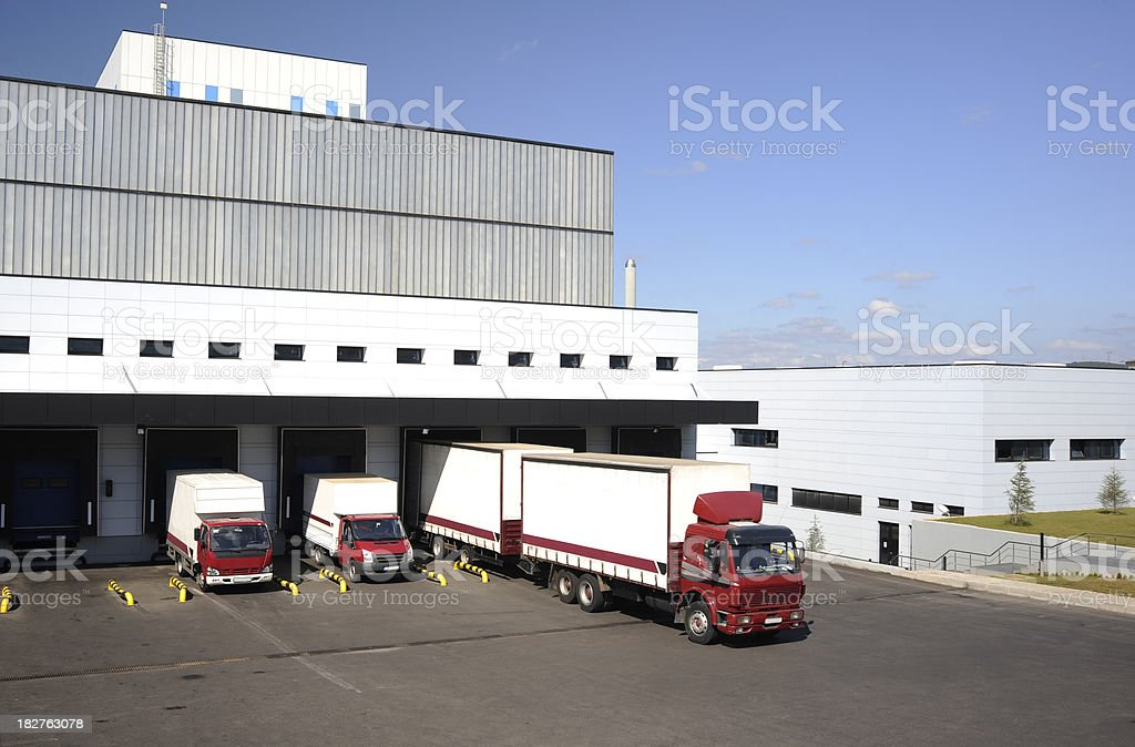 Freight trucks at loading royalty-free stock photo