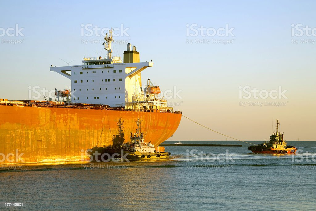 Freighter Being Guided by Tugs Close Up on Bridge royalty-free stock photo