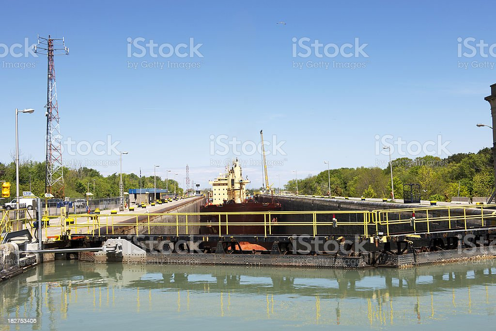 Freighter entering Lift Lock stock photo