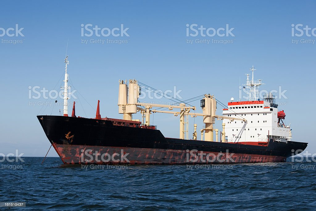 Freighter in anchor royalty-free stock photo