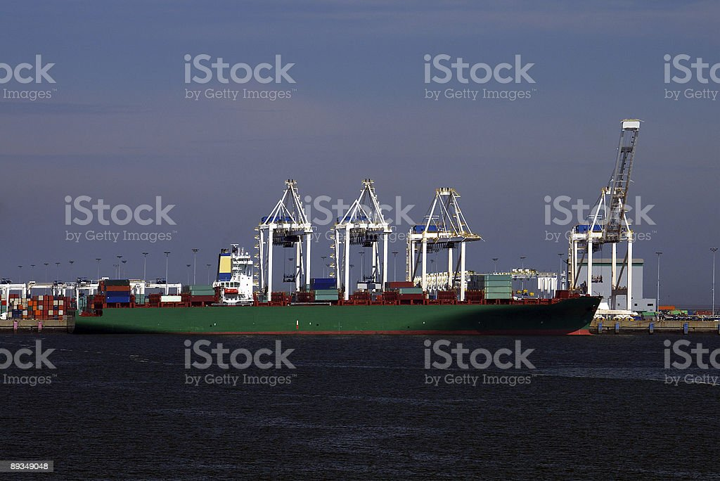 Freighter Loading Shipping Containers stock photo