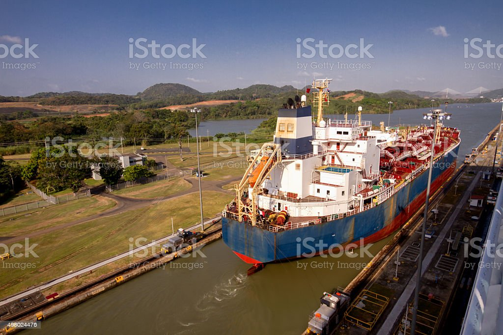 Freighter Ship Passing Through Panama Canal stock photo