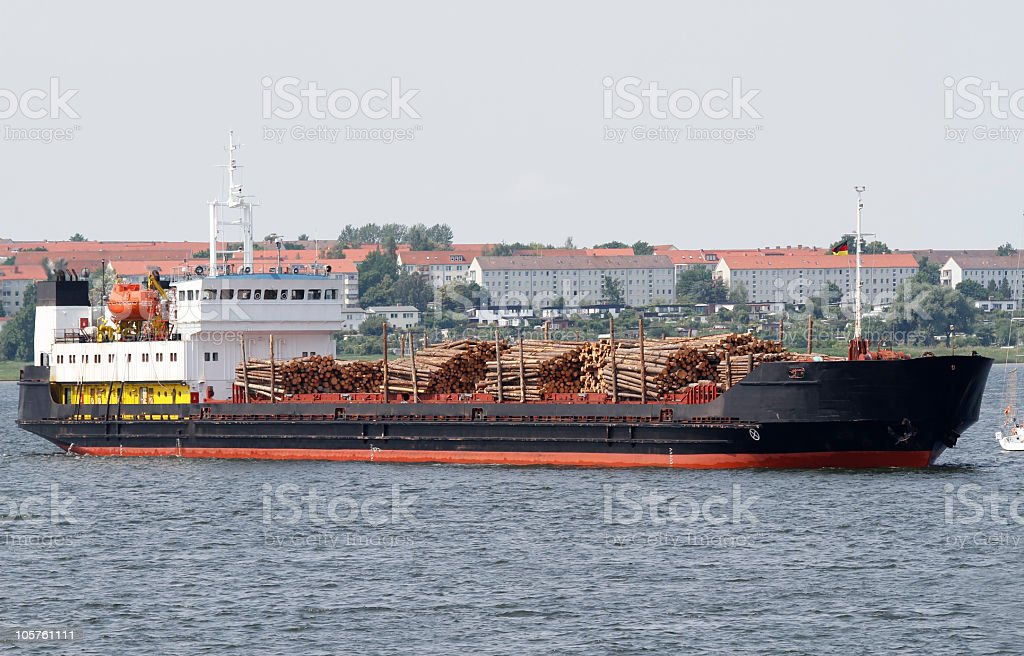 Freighter with wood stock photo