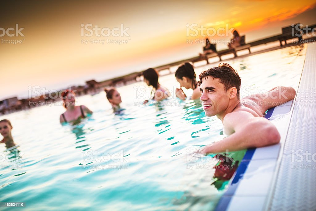 freind relaxing on the pool during the party stock photo