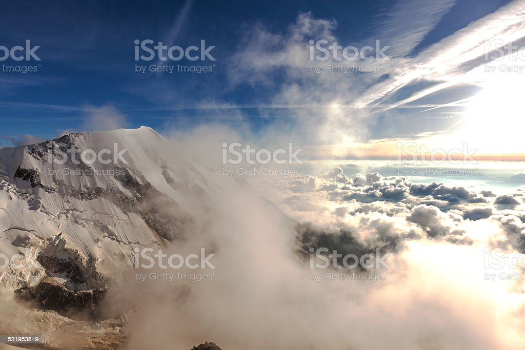 French Alps in the clouds during sunset stock photo