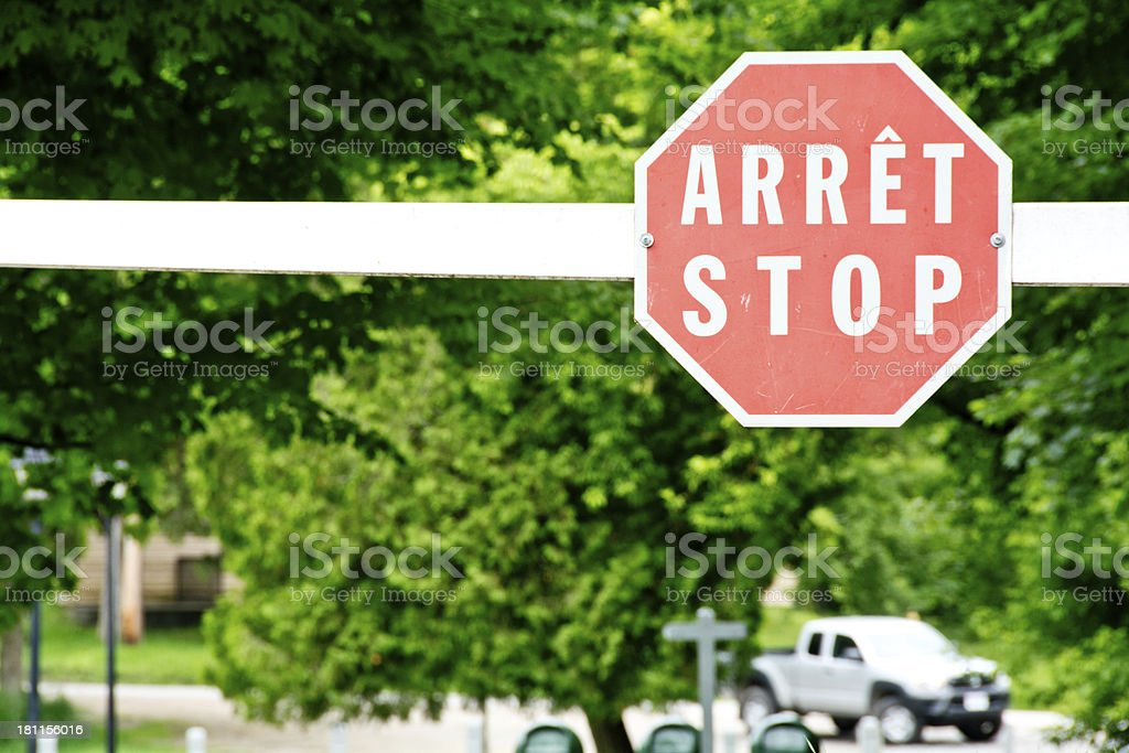 French and English bilingual stop sign stock photo
