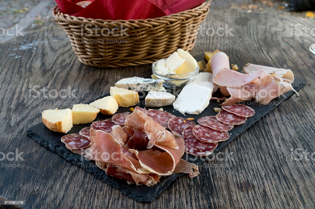 French appetizer with salami, cheese and ham stock photo