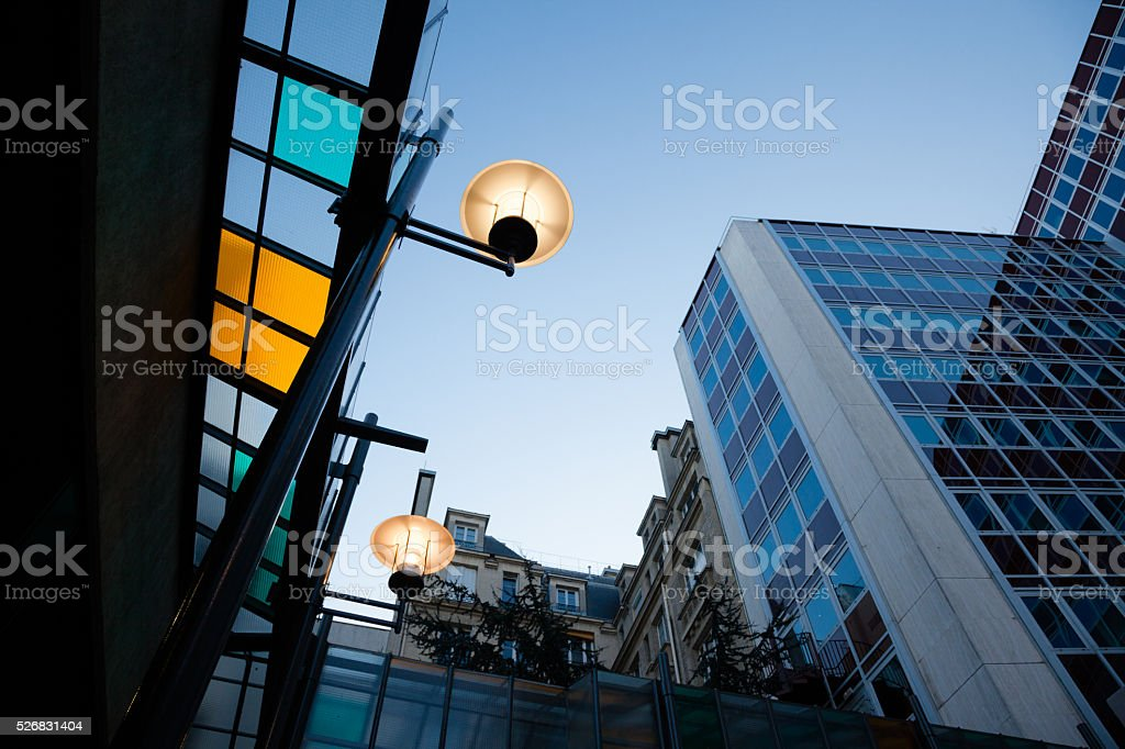 french architecture old and new at night stock photo