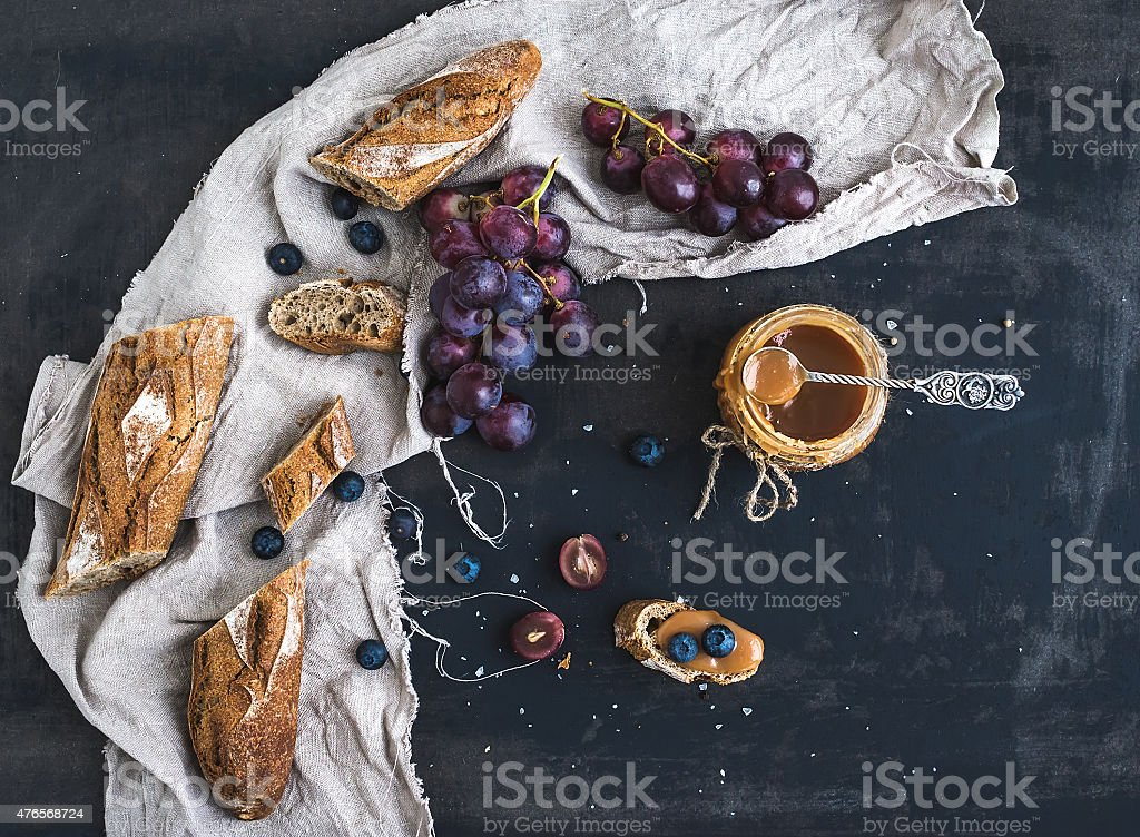 French baguette cut into pieces, red grapes, blueberry and salt stock photo