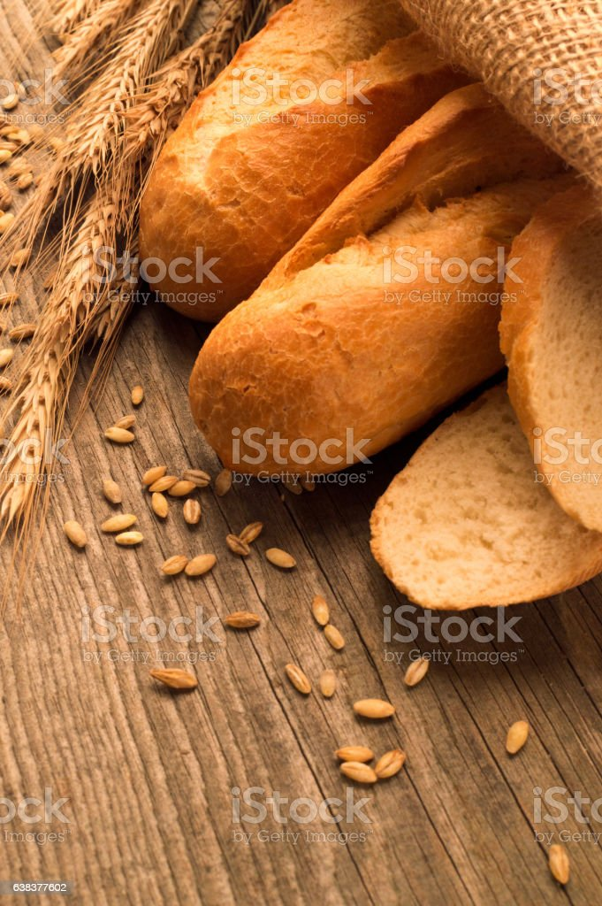 French baguette sliced on the wooden desk stock photo