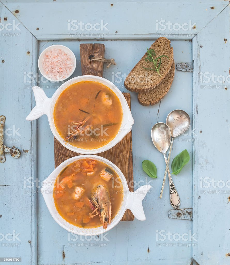 French Bouillabaisse fish tomato soup with salmon fillet, shrimp and stock photo