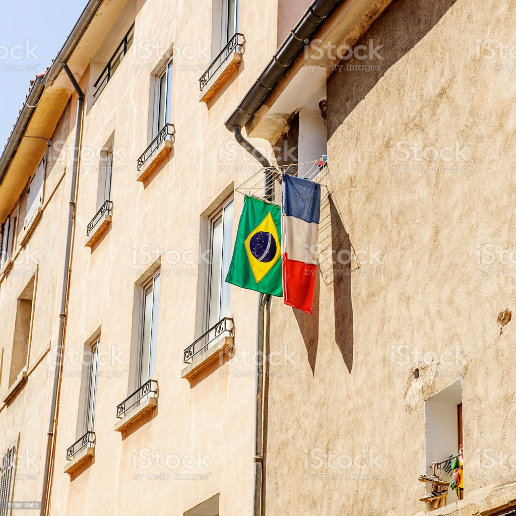 French Brazilian flag hanged outside the window in the city stock photo