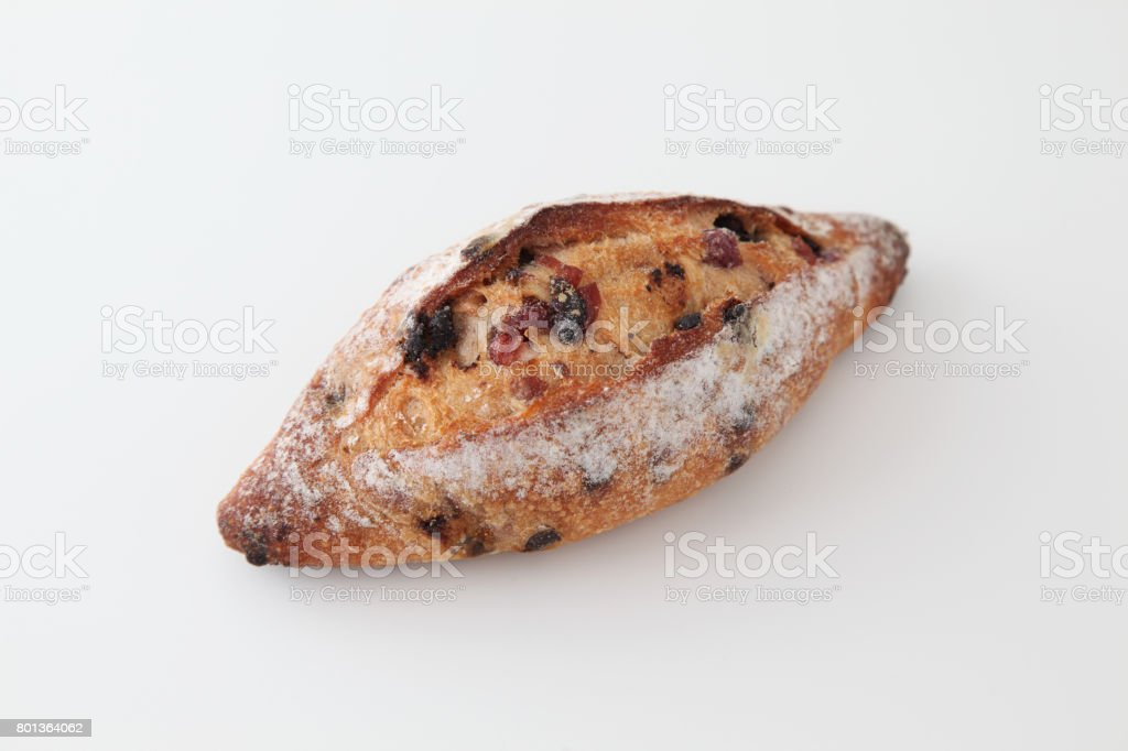 french bread with dried fruit cranberries and choco chips white background stock photo