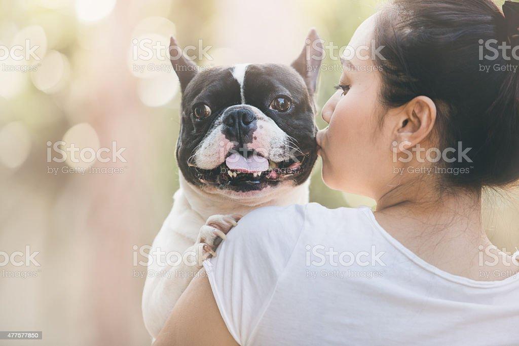 french bulldog kiss girl stock photo