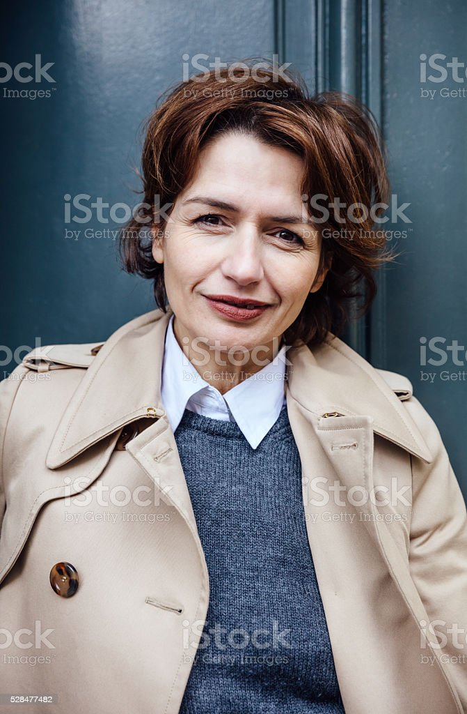 french businesswoman standing at the door stock photo