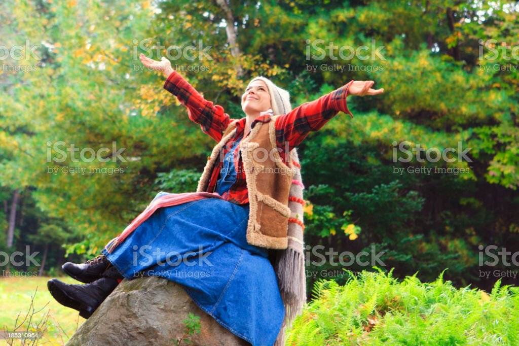 French Canadian Woman telling A Story On The Mountain royalty-free stock photo