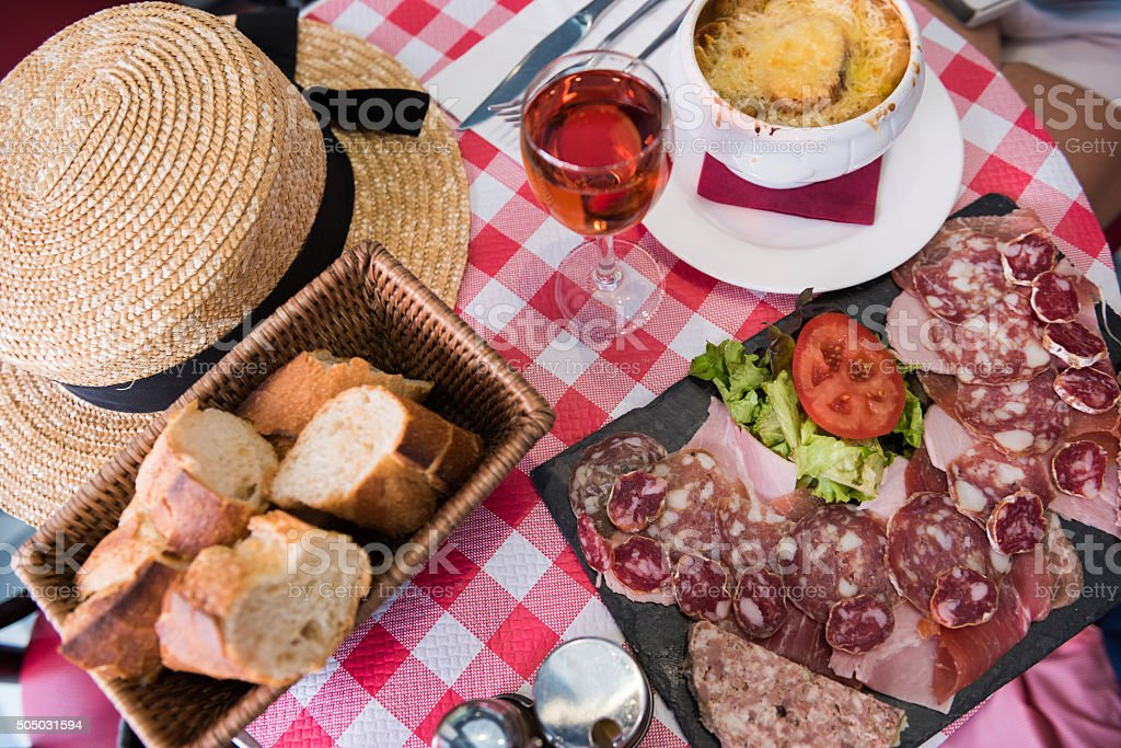 French charcuterie platter and french onion soup stock photo