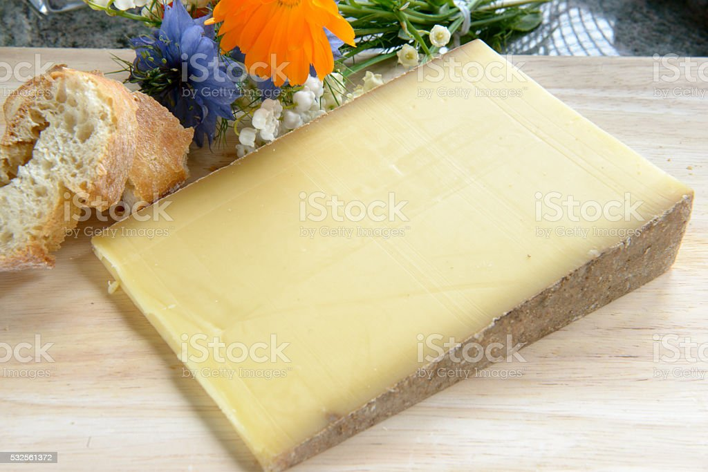 french cheese Comte on a wooden tray stock photo