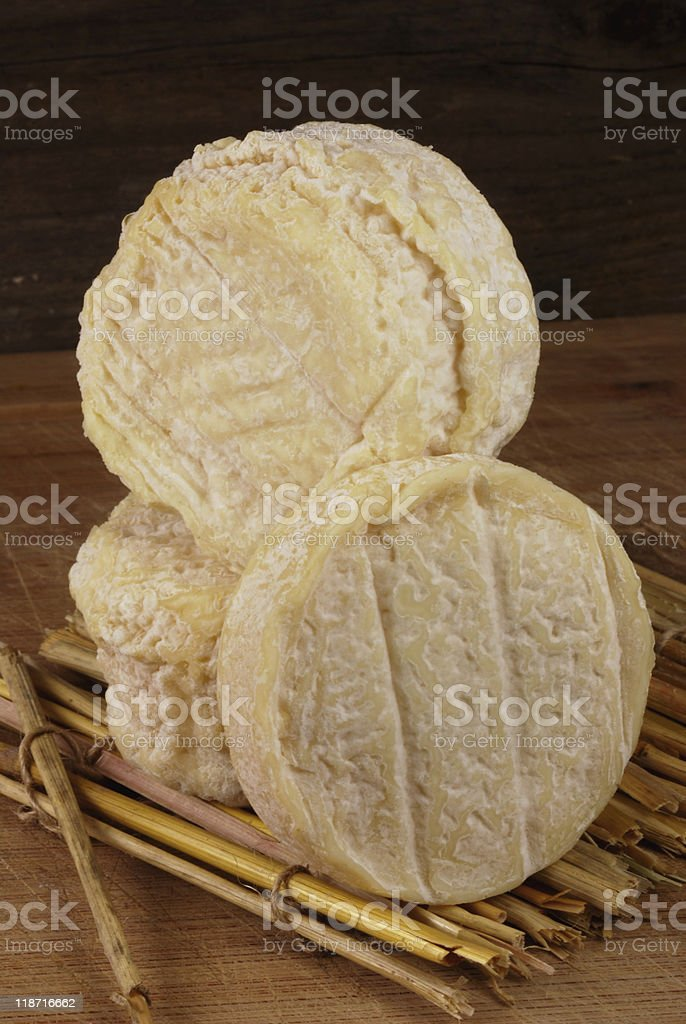 french cheese on straw mat stock photo