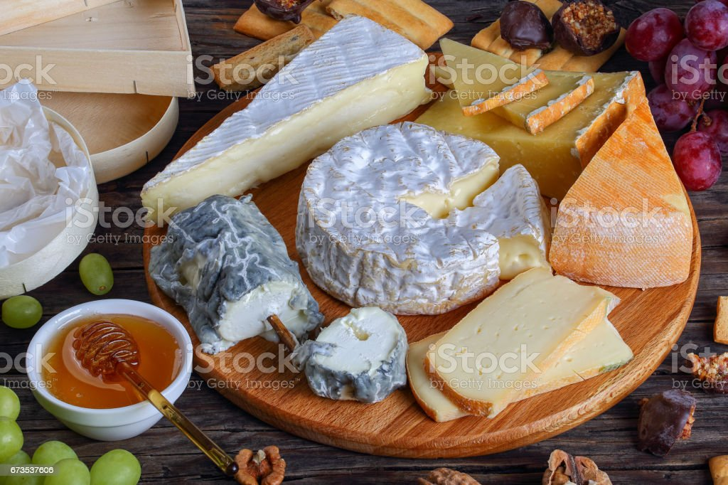 french Cheese plate served with grapes stock photo