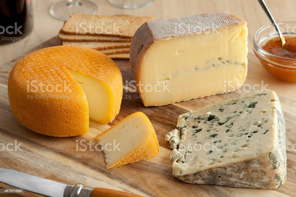 A French cheese platter on a wooden board stock photo