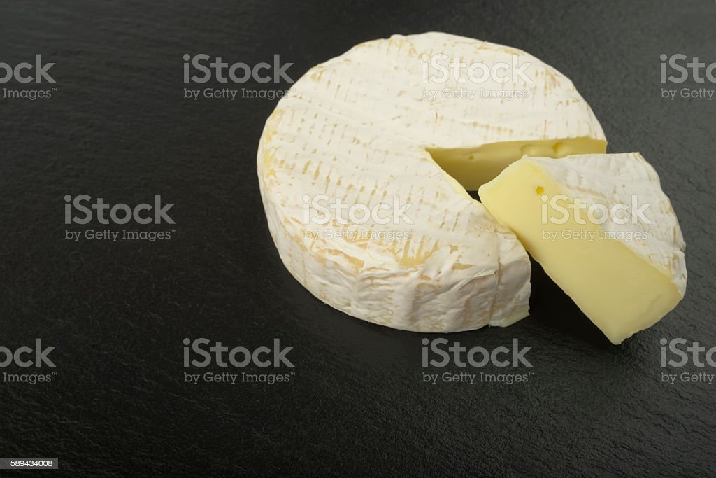 french cheese - round camembert with cut slice stock photo