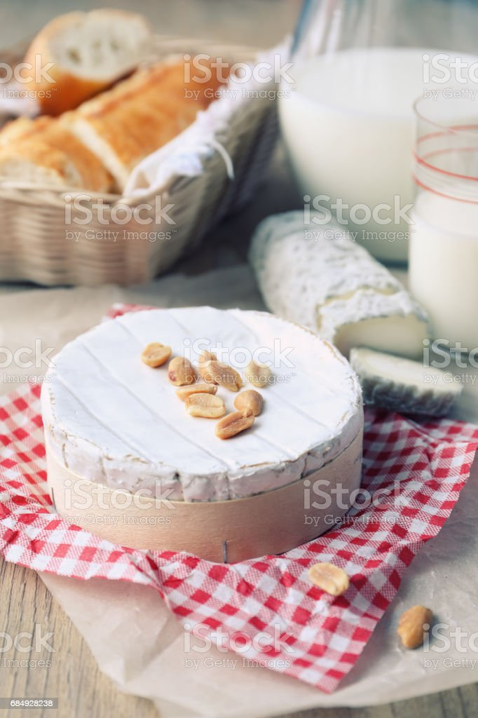 French cheeses, baguette and milk stock photo