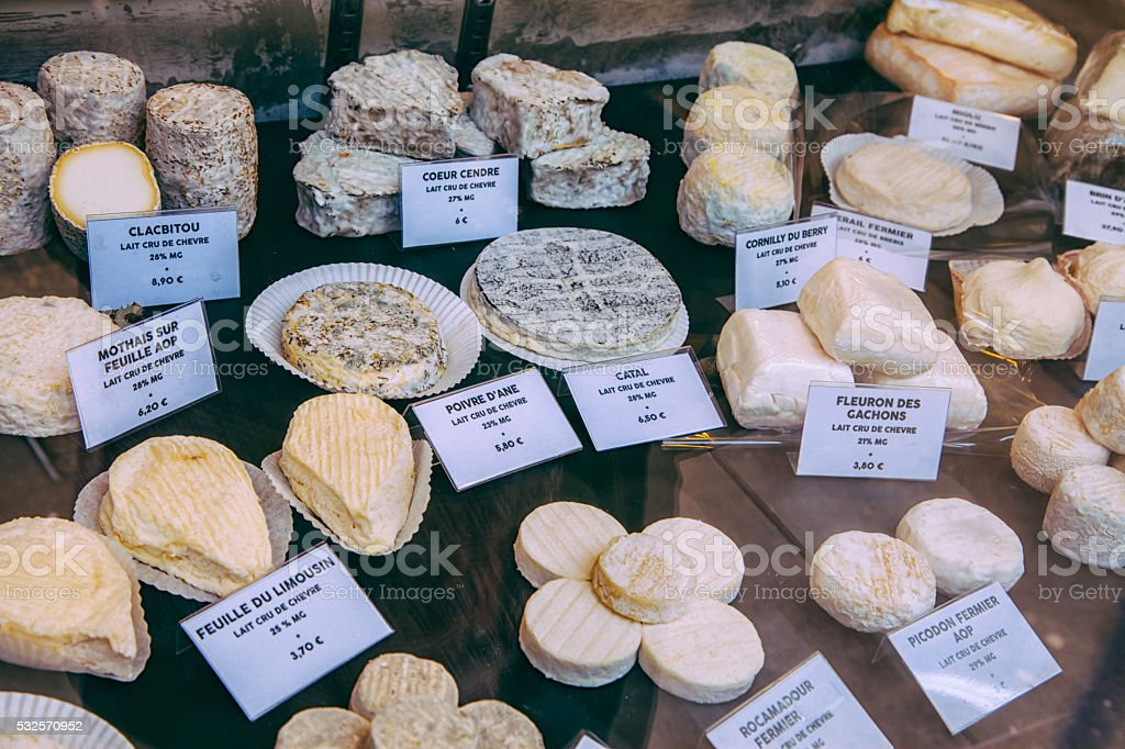 French cheeses on market stall stock photo
